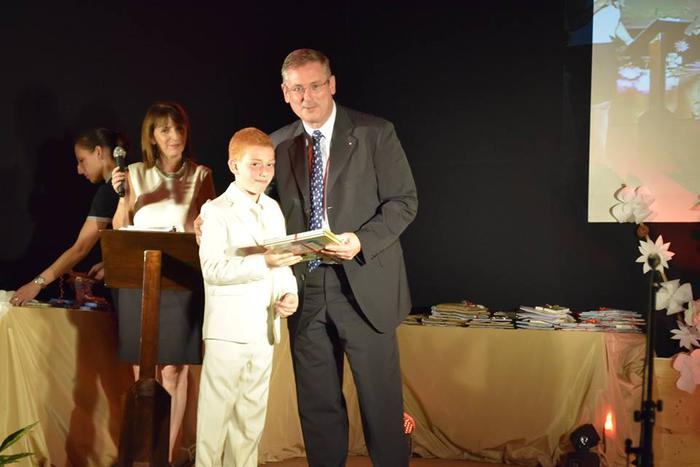 Ceremony of graduation in St Charles School: the students gets his diploma