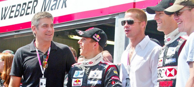 """Main actors of """"Ocean's 12"""", George Clooney and Brad Pitt at the pitstop of Formula-1"""