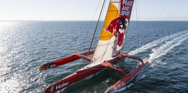 Trimaran baring the colours of the organisation he was sailing in aid for (Peace and Sport)