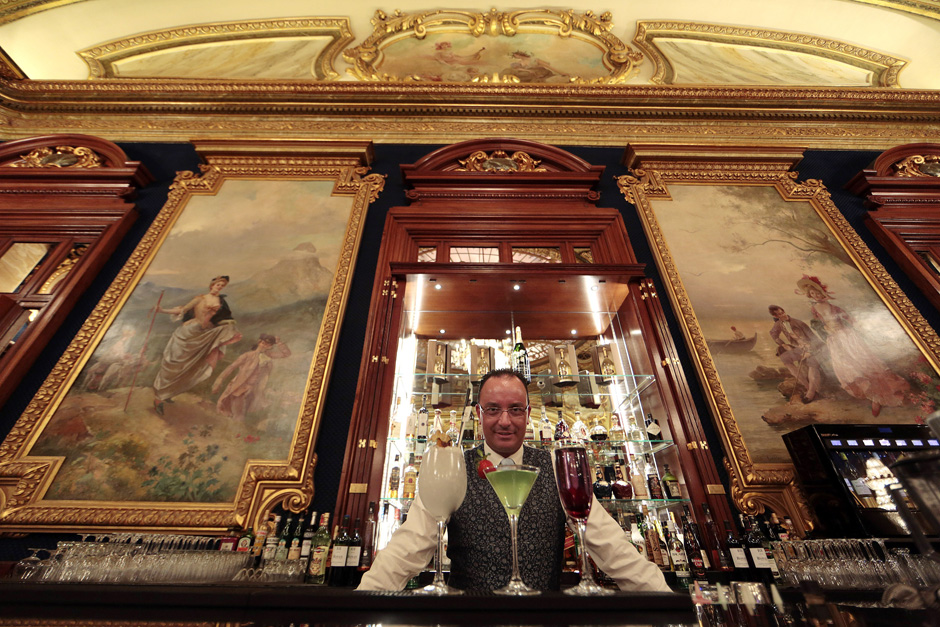 Barman Vincenzo Pentasuglia of Italy poses behind the bar in the Salon Europe at the Casino de Monte Carlo in Monaco