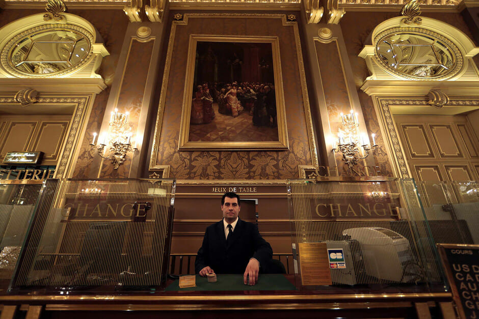 Assistant cashier Gregory Francois of Monaco poses in the Salle des Ameriques, also known as Salle de Jeux Garnier, at the Casino de Monte Carlo in Monaco