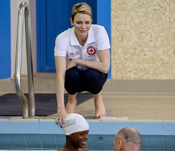 children First Aid, Princess Charlene gave them a swimming lesson.