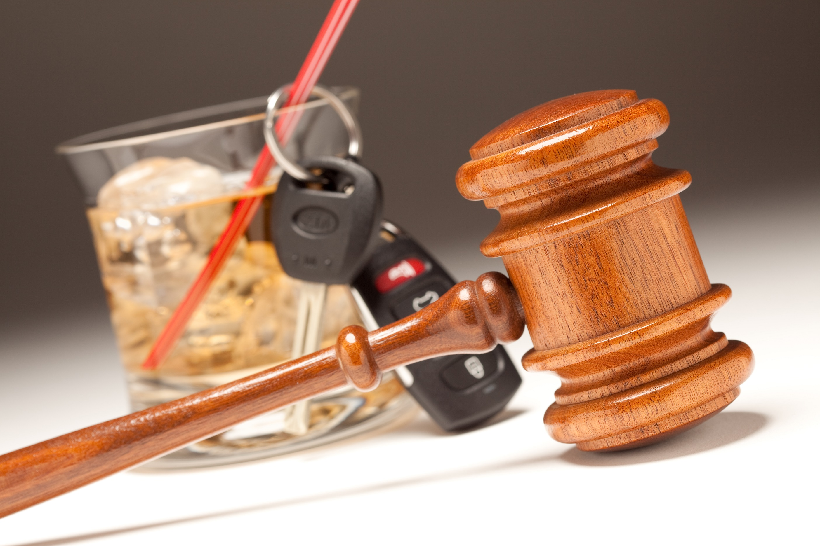 Gavel, Alcoholic Drink and Car Keys