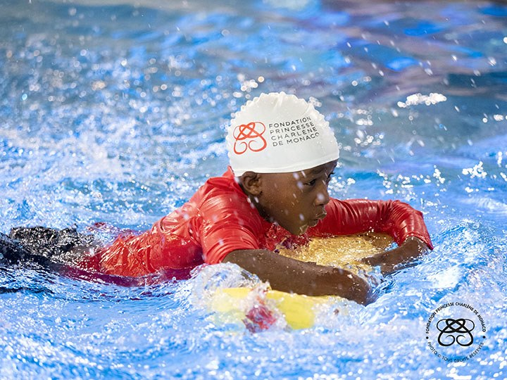 Princess Charlene gives Swimming Workshop to Saint Devote Rugby Players