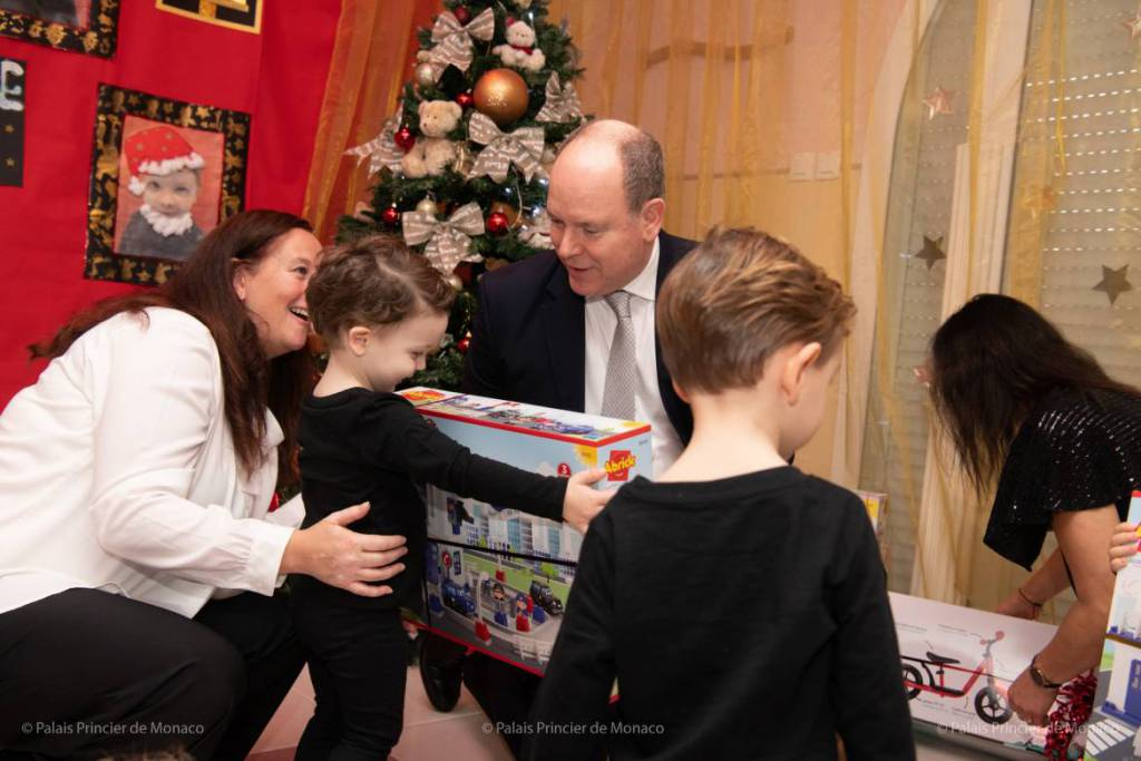 Prince Albert and Princess Charlene give out Red Cross Christmas Gifts