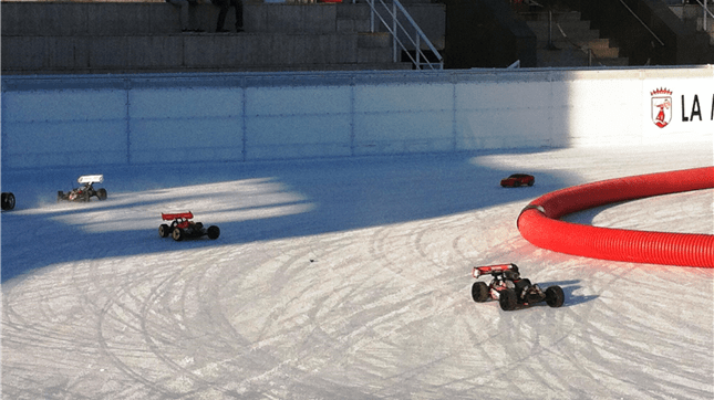 Electric radio-controlled cars on the open-air skating rink