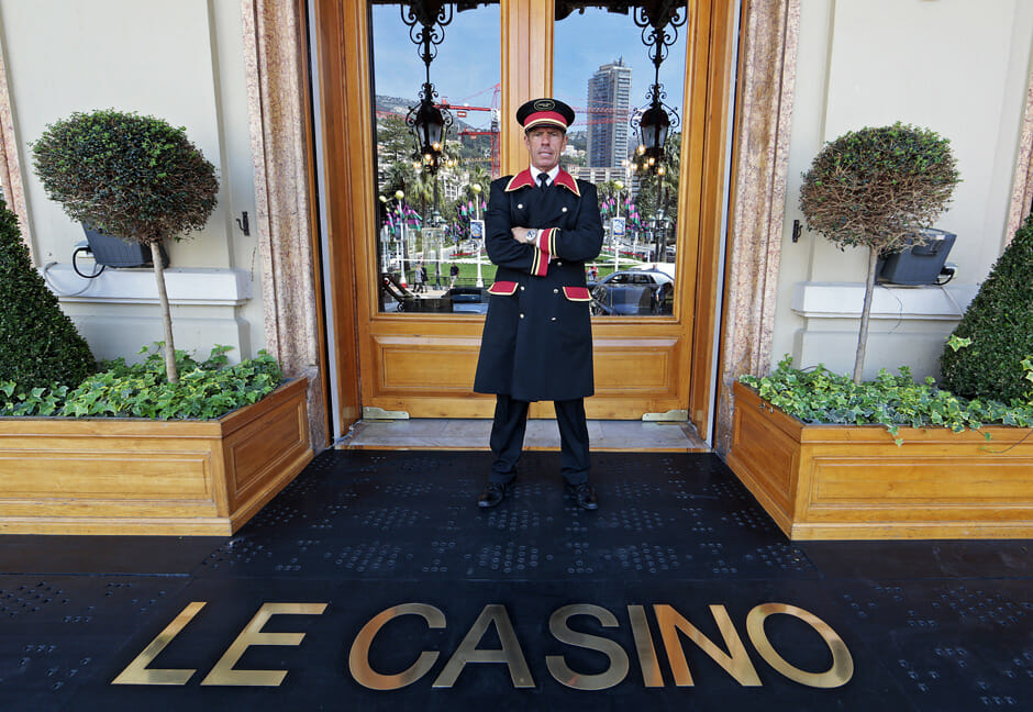 Richard Logli of Monaco, who is head of valet parking and a doorman, poses at the main entrance of the Casino de Monte Carlo in Monaco