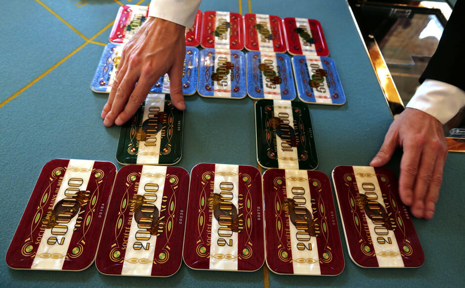 A croupier sets up plaques, with a value of 200,000 euros ($274,380) each, in the private rooms of the Salle Blanche at the Casino de Monte Carlo in Monaco