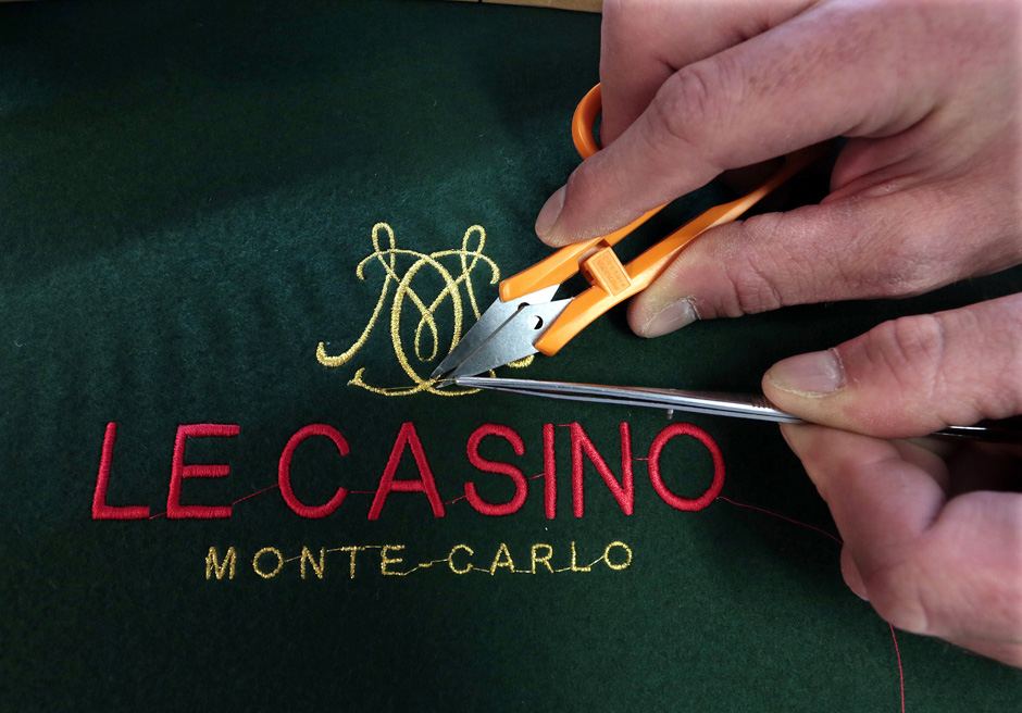 Gaming workshop tapestry maker Fabien Bazzini of France puts the final touches to the embroidery of a gambling table green in the Casino de Monte Carlo workshop in Monaco