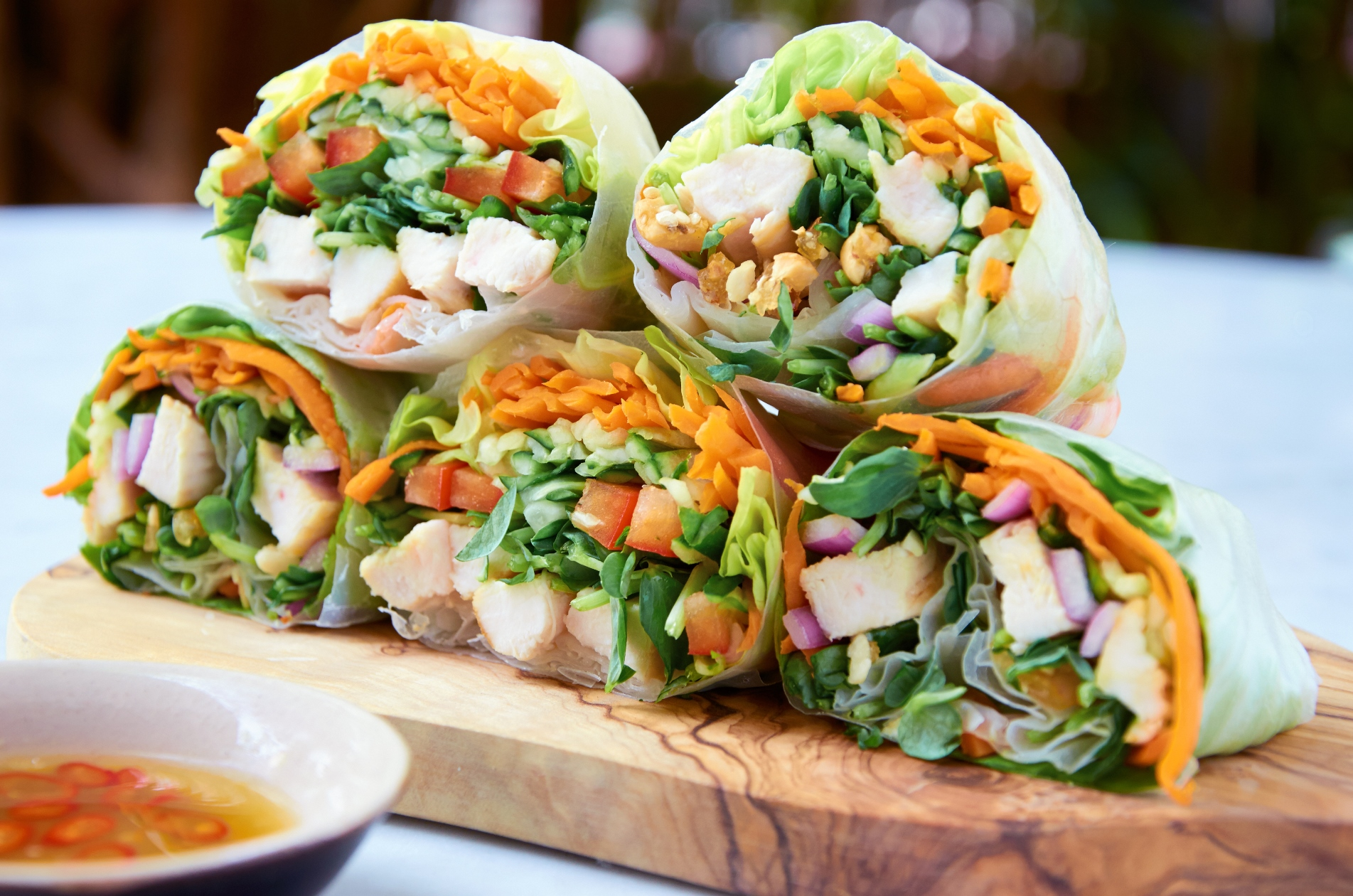 Serving healthy fresh asian spring roll wraps