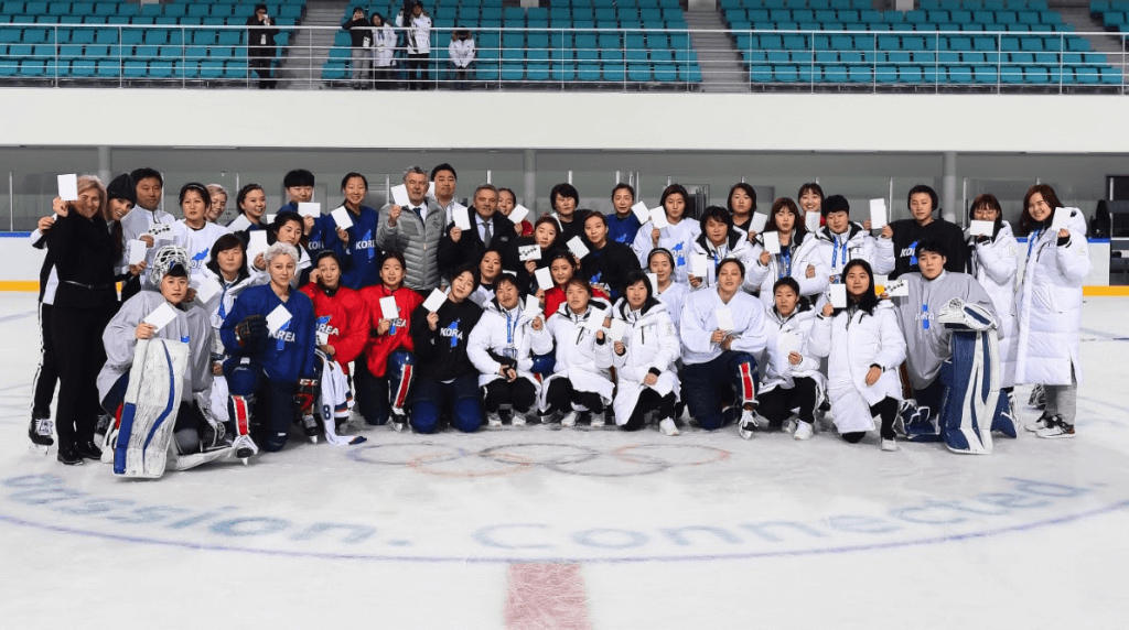 Photo of Korean Women's Ice Hockey Teams Unified for a Historical #WhiteCard Photo