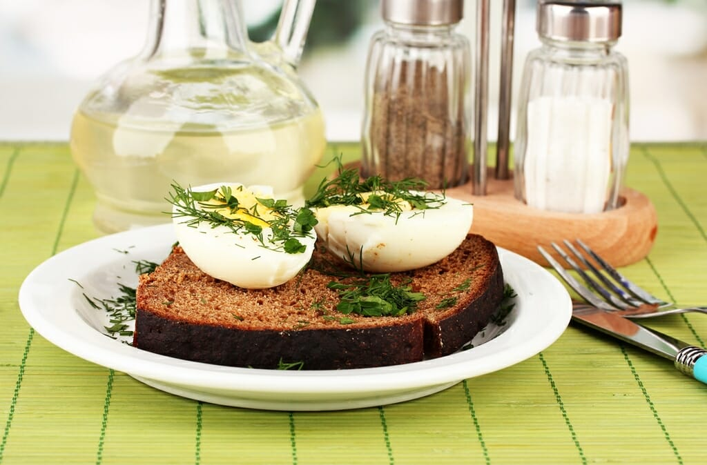 Boiled eggs on dark bread
