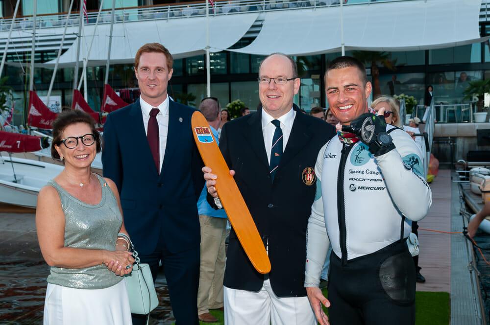 Prince Albert II greets marathon water skier Alex Luther