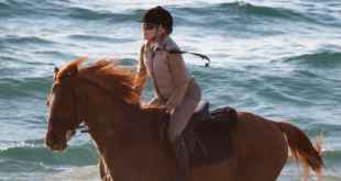 Horseback riding on a beach in Portugal with Madonna