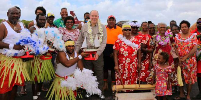 Prince Albert with artist Alick Tipoti on Badu