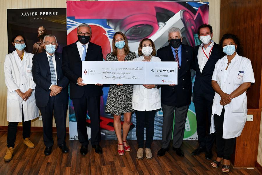 Compagnie Monégasque de Banque presents cheque for €470,955 to Princess Grace Hospital